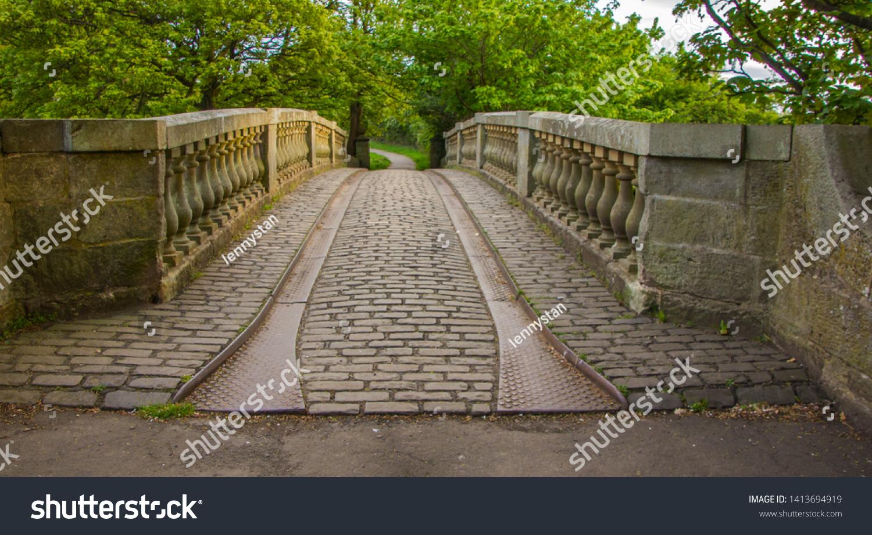 stock-photo-stone-bridge-over-white-cart