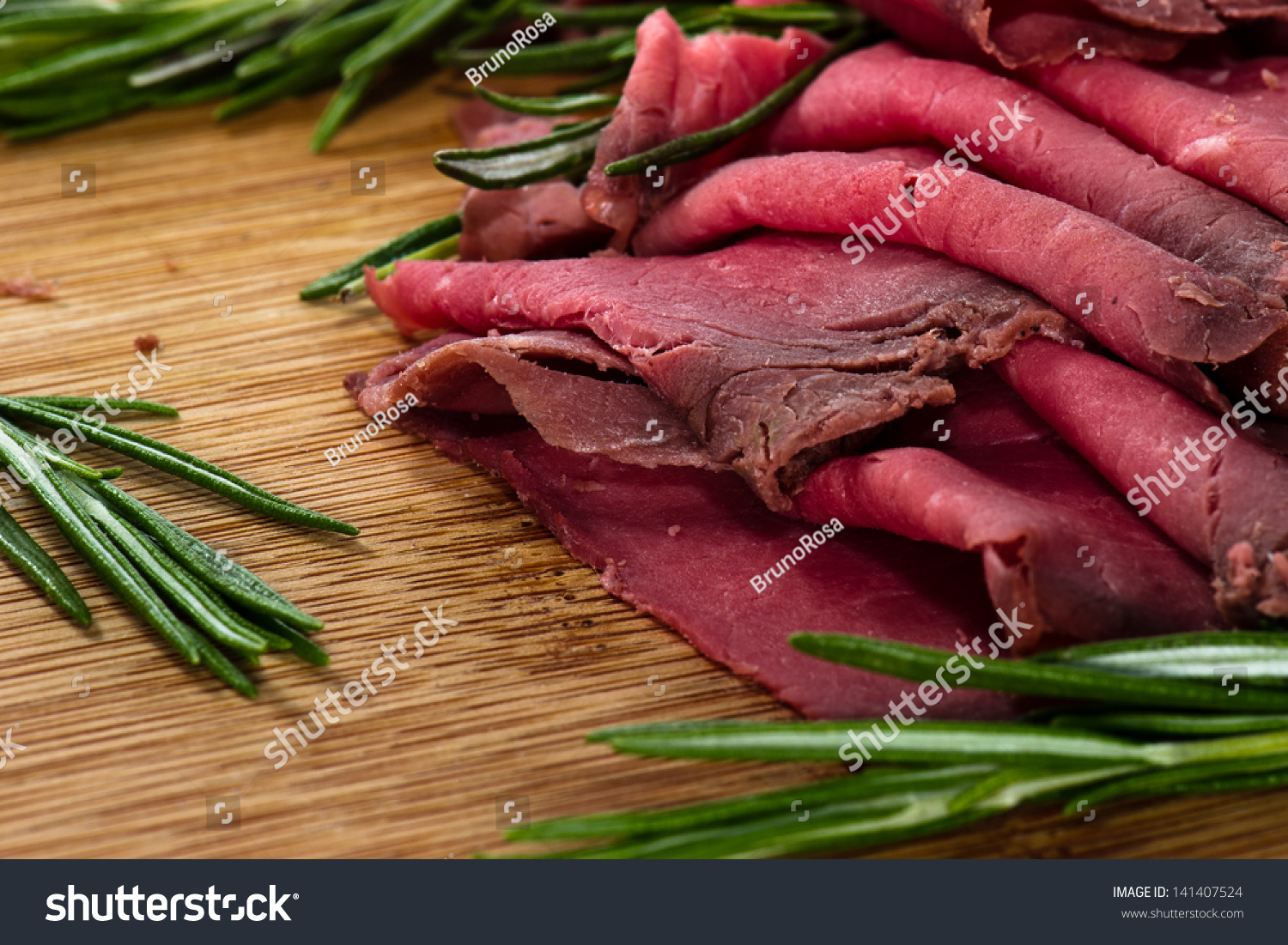 Sliced roast beef package - Slices Of Roast Beef With Cheese And Rosemary On Wooden Board