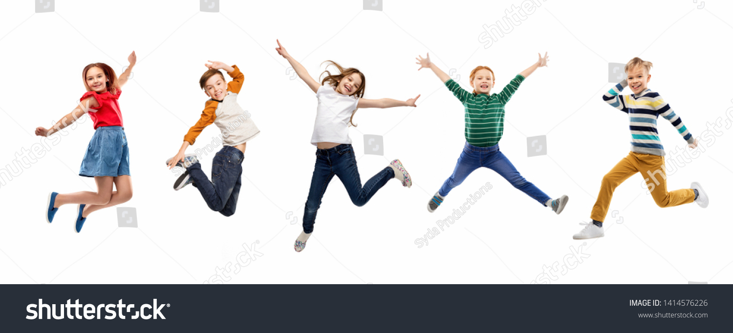 childhood, fun and motion concept - happy children jumping over white background #1414576226