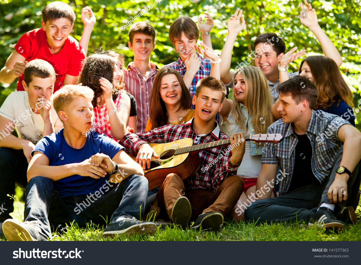 Group Of Young People Singing In Unison By Guitar Stock ... Group Singing Images