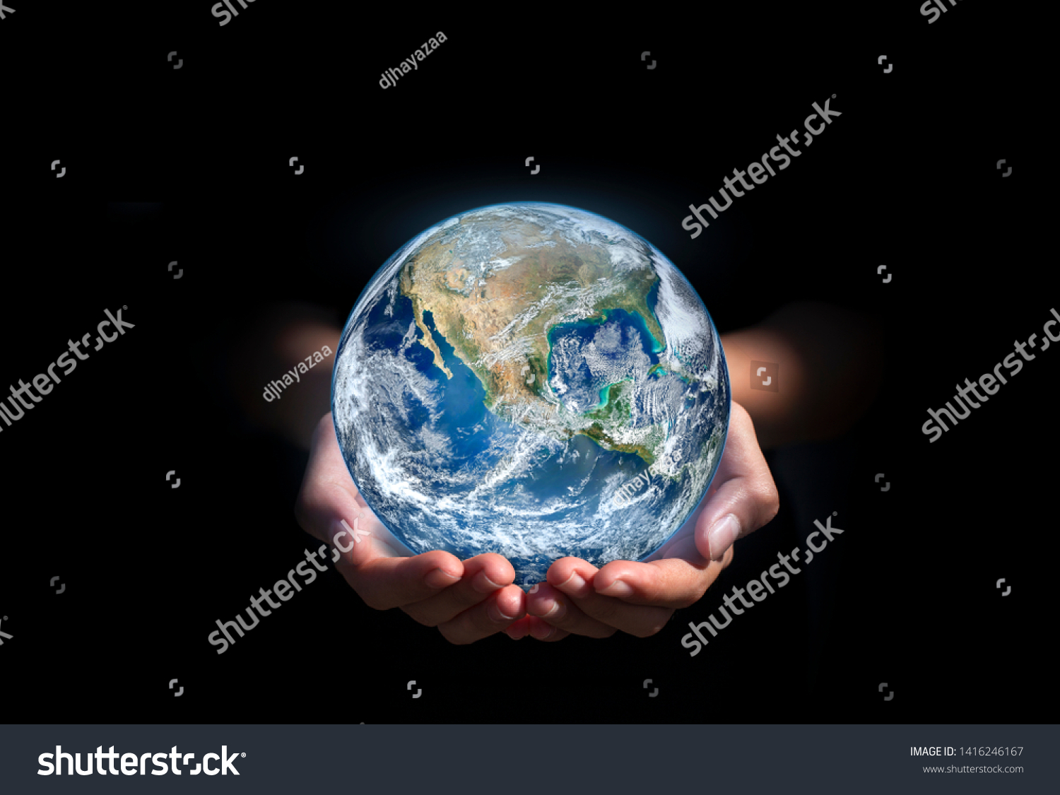 earth in hands. green planet on hand. save of earth. environment concept for background web or world guardian organization.Elements of this image furnished by NASA #1416246167