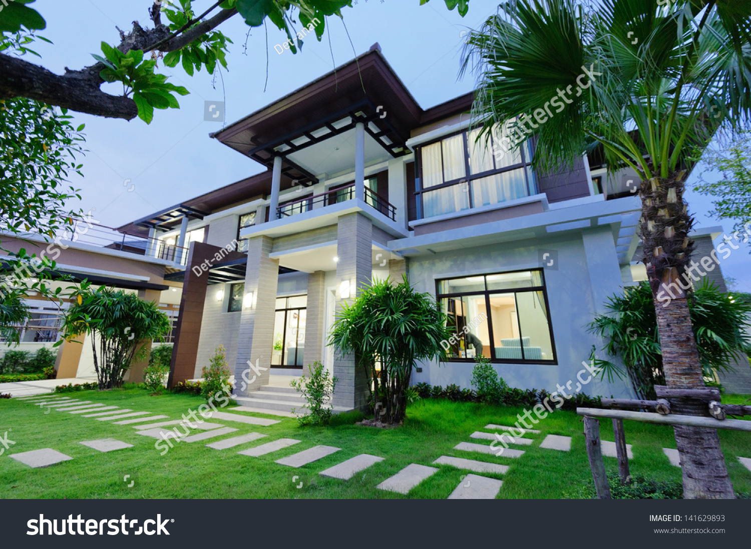 Modern house night stock photo 141629893 shutterstock for Modern house at night