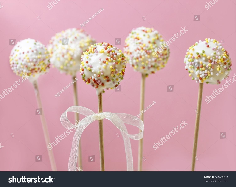 Cake pops decorated sprinkles on pink stock photo edit now cake pops decorated with sprinkles on pink background izmirmasajfo