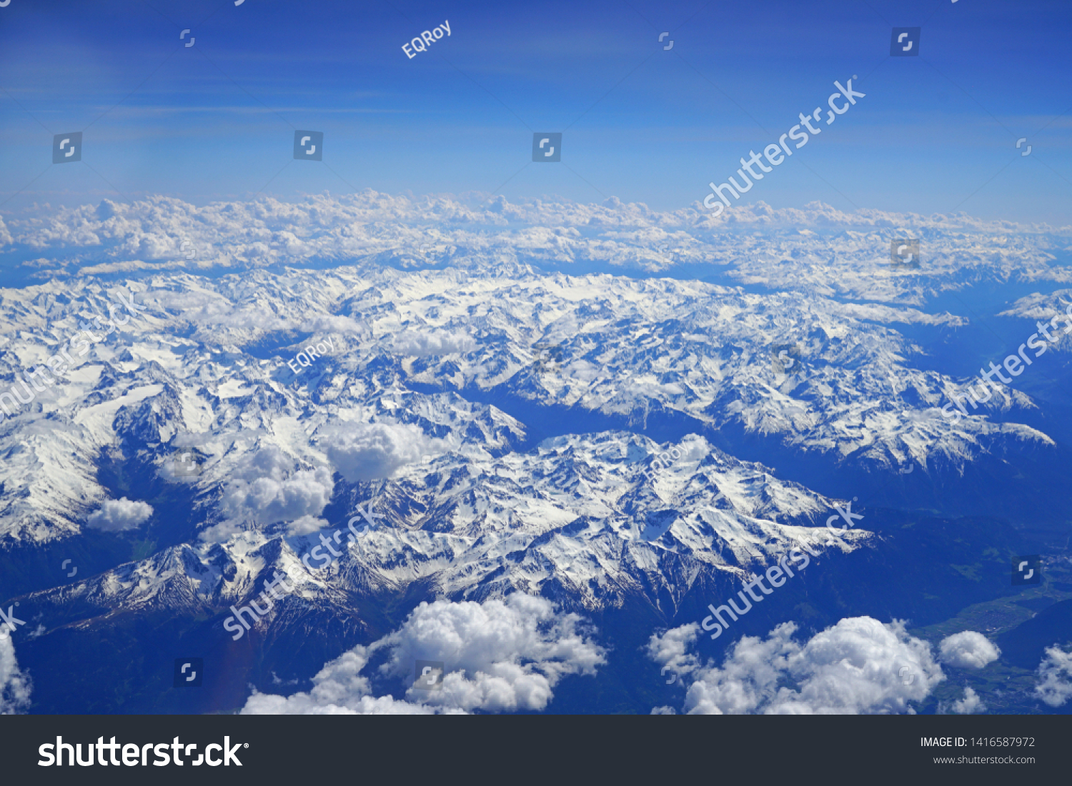 Aerial view of the Alps Mountains covered with snow over France and Switzerland #1416587972