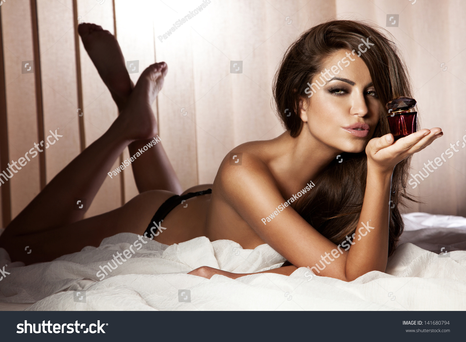 naked beautiful brunette woman lying bed stock photo & image
