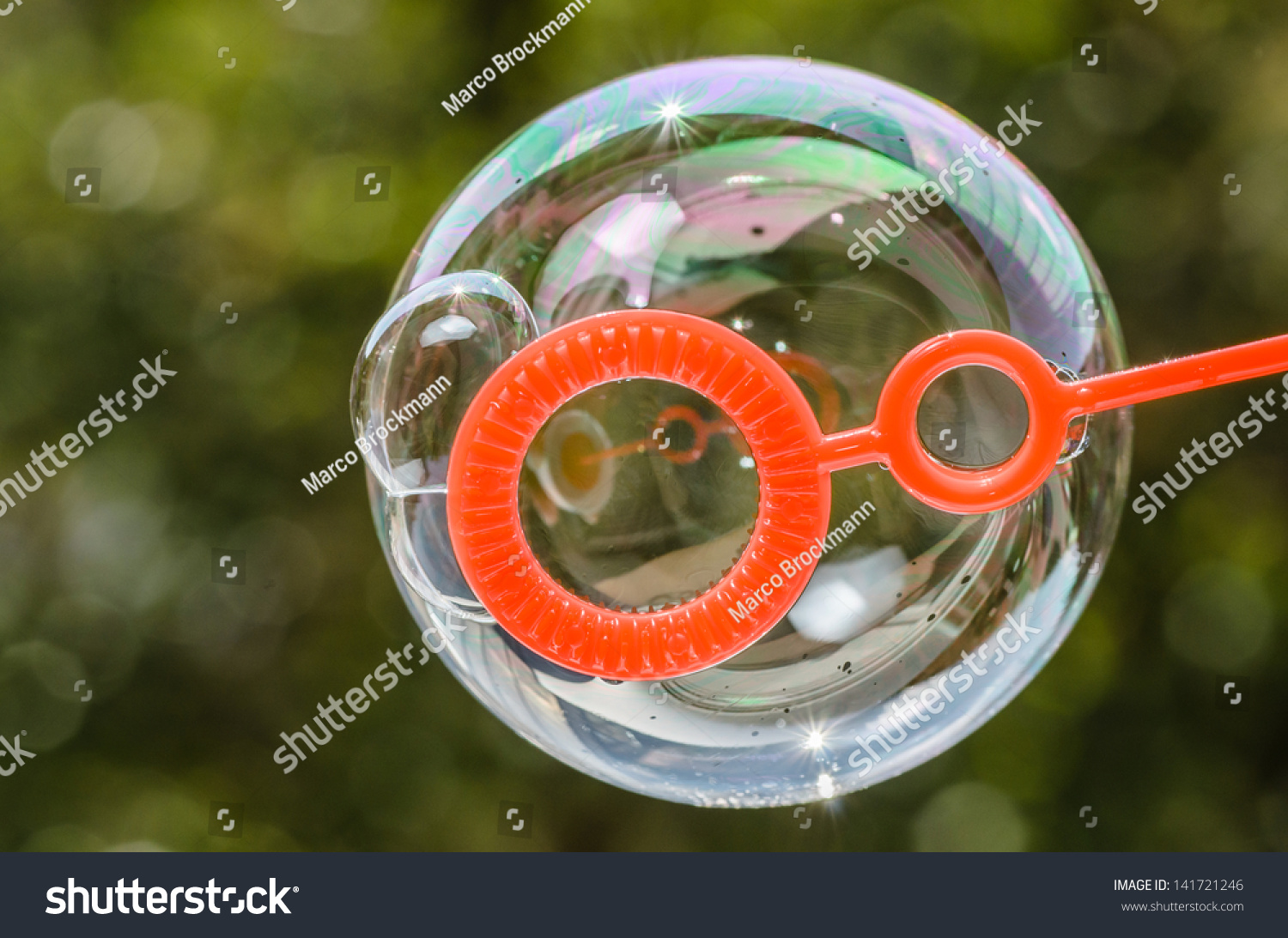 Ring Bubble Blowers : Close soap bubble growing blower ring stock photo