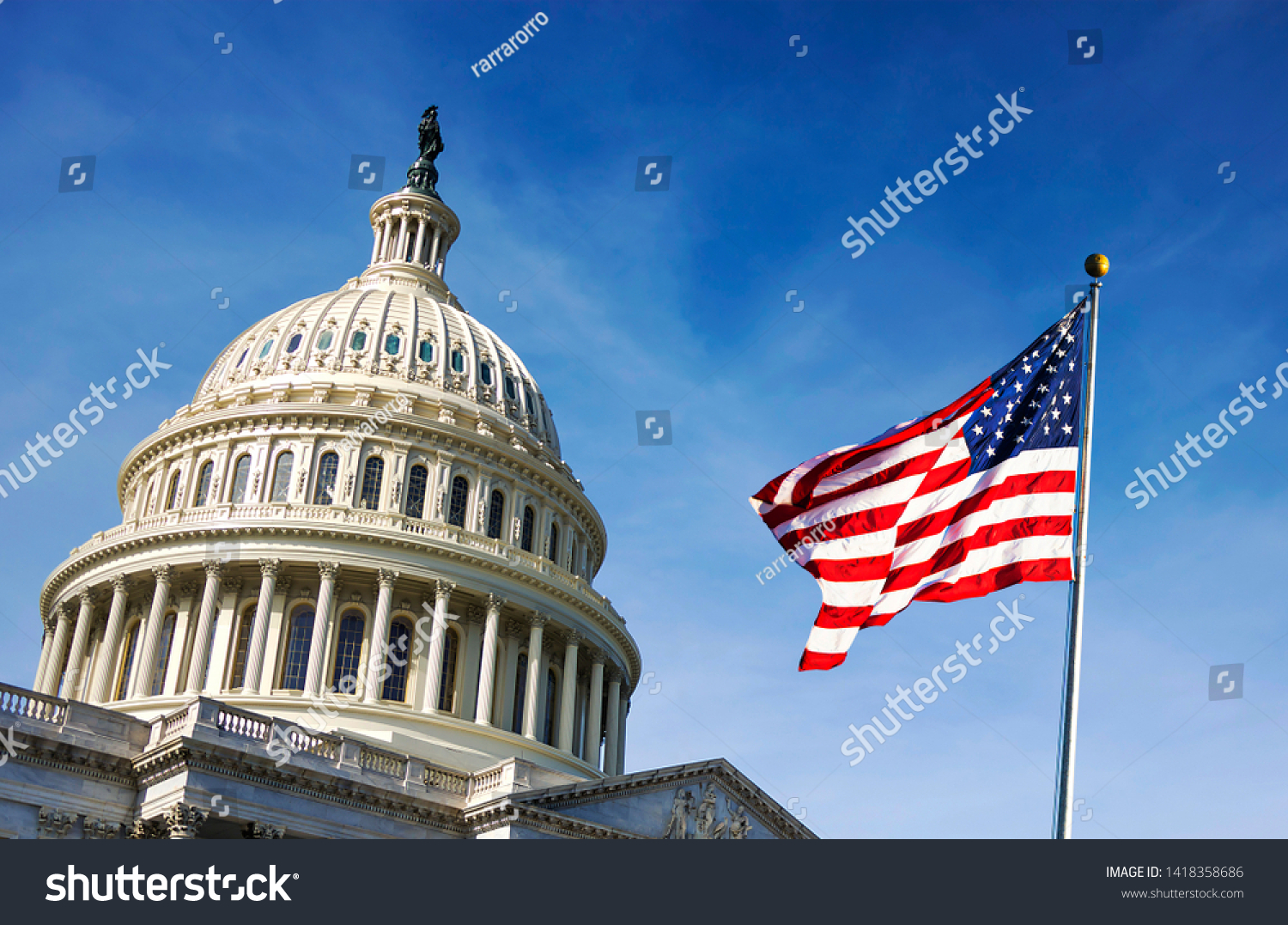 American flag waving with the Capitol Hill in the background #1418358686