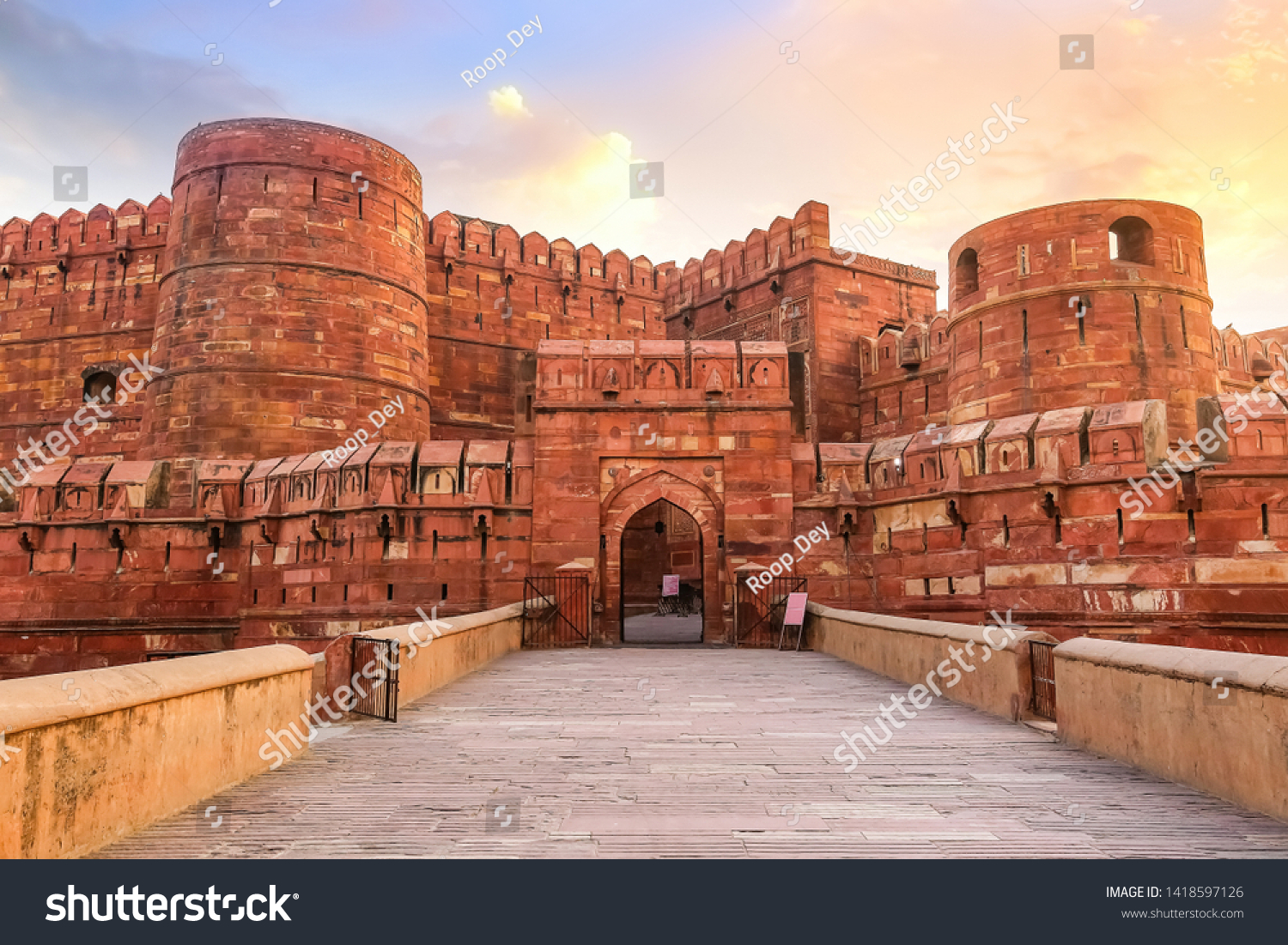 Agra Fort - Historic red sandstone fort of medieval India at sunrise. Agra Fort is a UNESCO World Heritage site in the city of Agra India. #1418597126