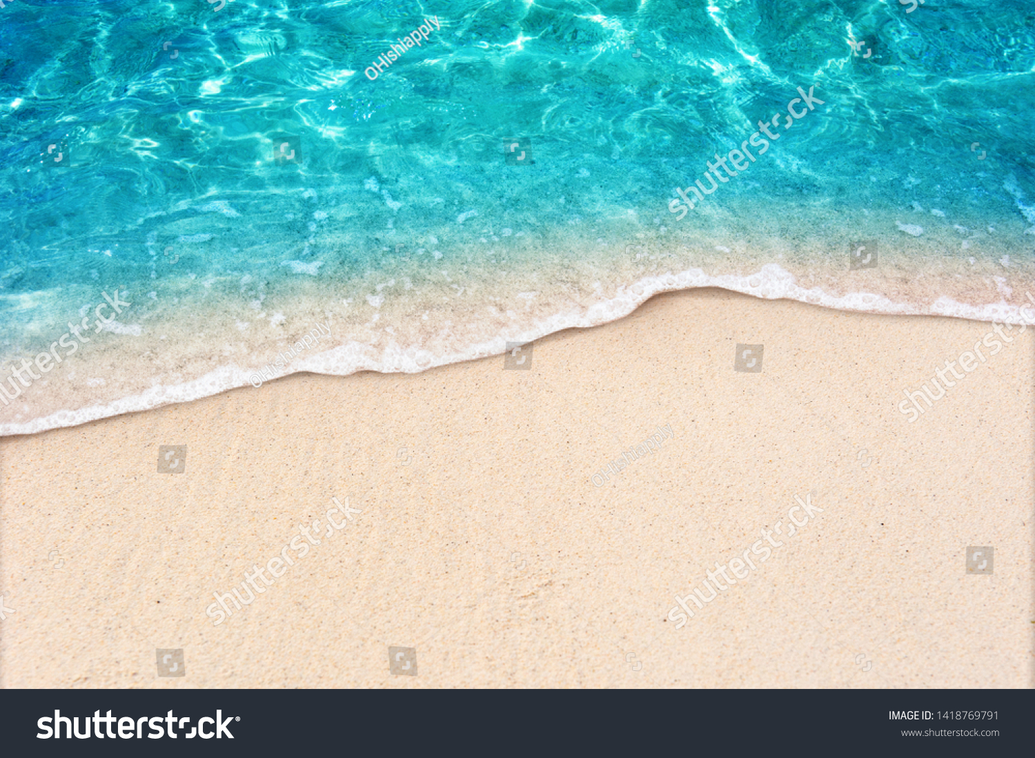 Soft blue ocean wave on clean sandy beach #1418769791