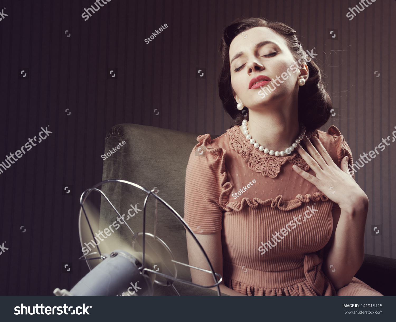 Cooling Off With Fan : Beautiful woman using fan cool off stock photo