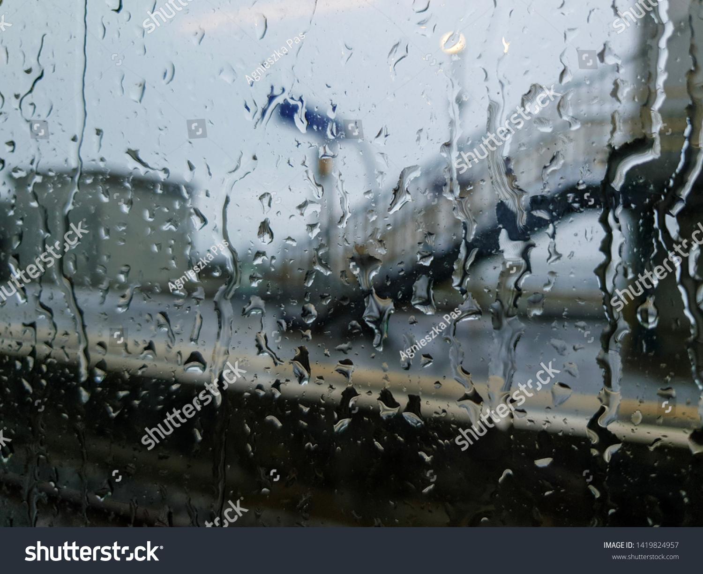 stock-photo-rain-drops-on-train-window-1