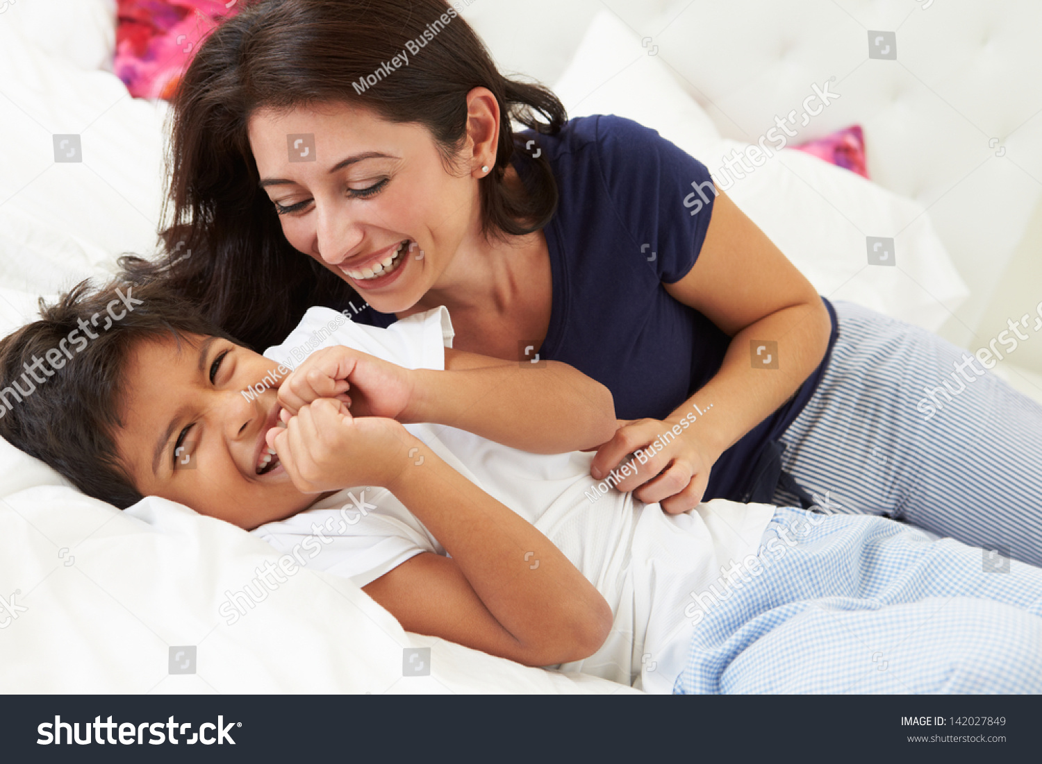 mom in bed with son