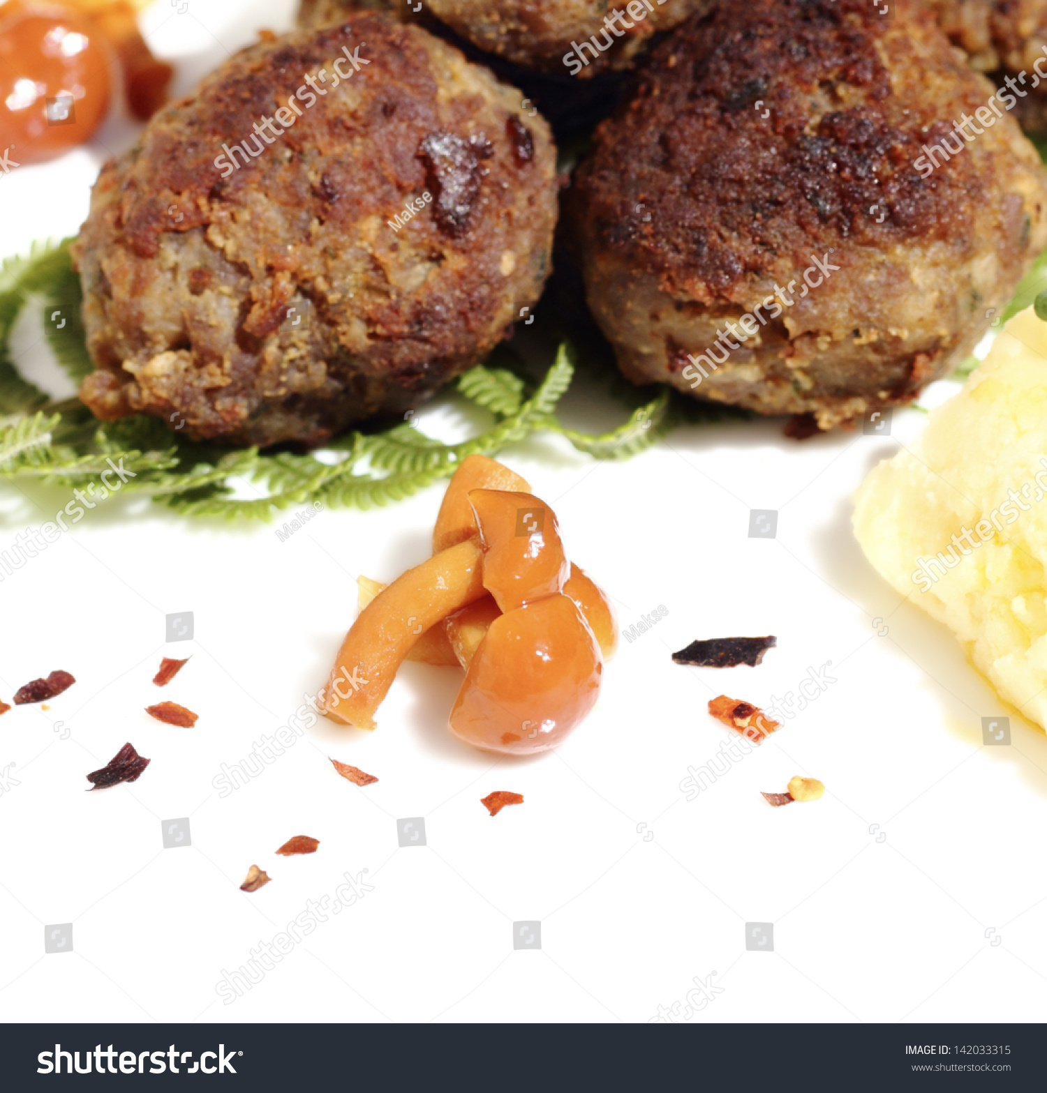 Marinated Mushrooms Served With Roasted Meatballs And Mashed Potatoes ...