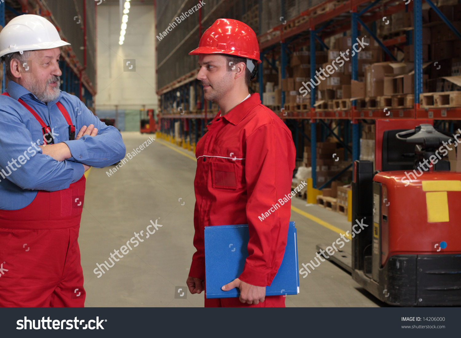 young older workers chat warehouse stock photo shutterstock young and older workers chat in warehouse