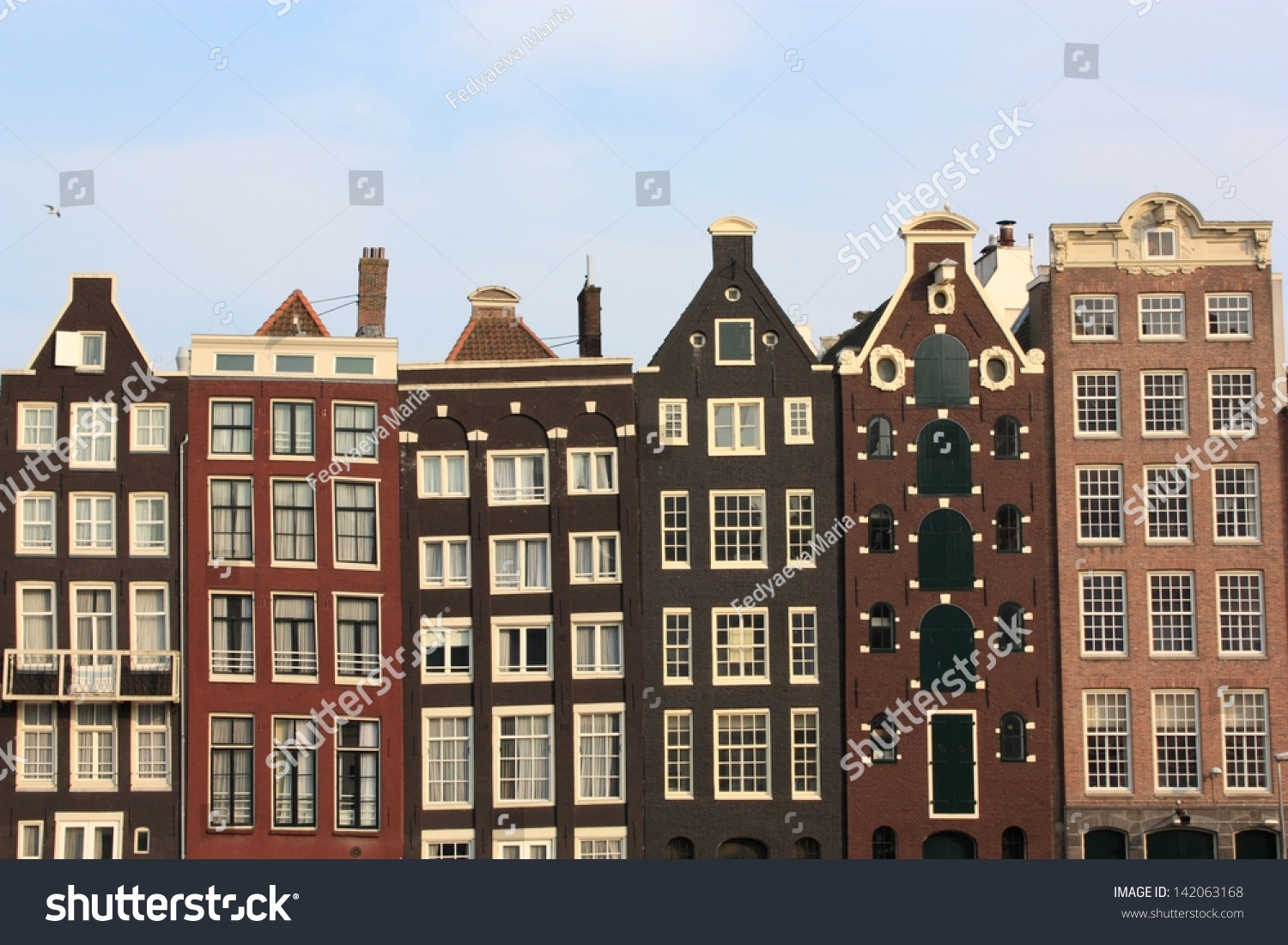 Typical dutch houses along amsterdam canal stock photo for Classic dutch house of 60m2