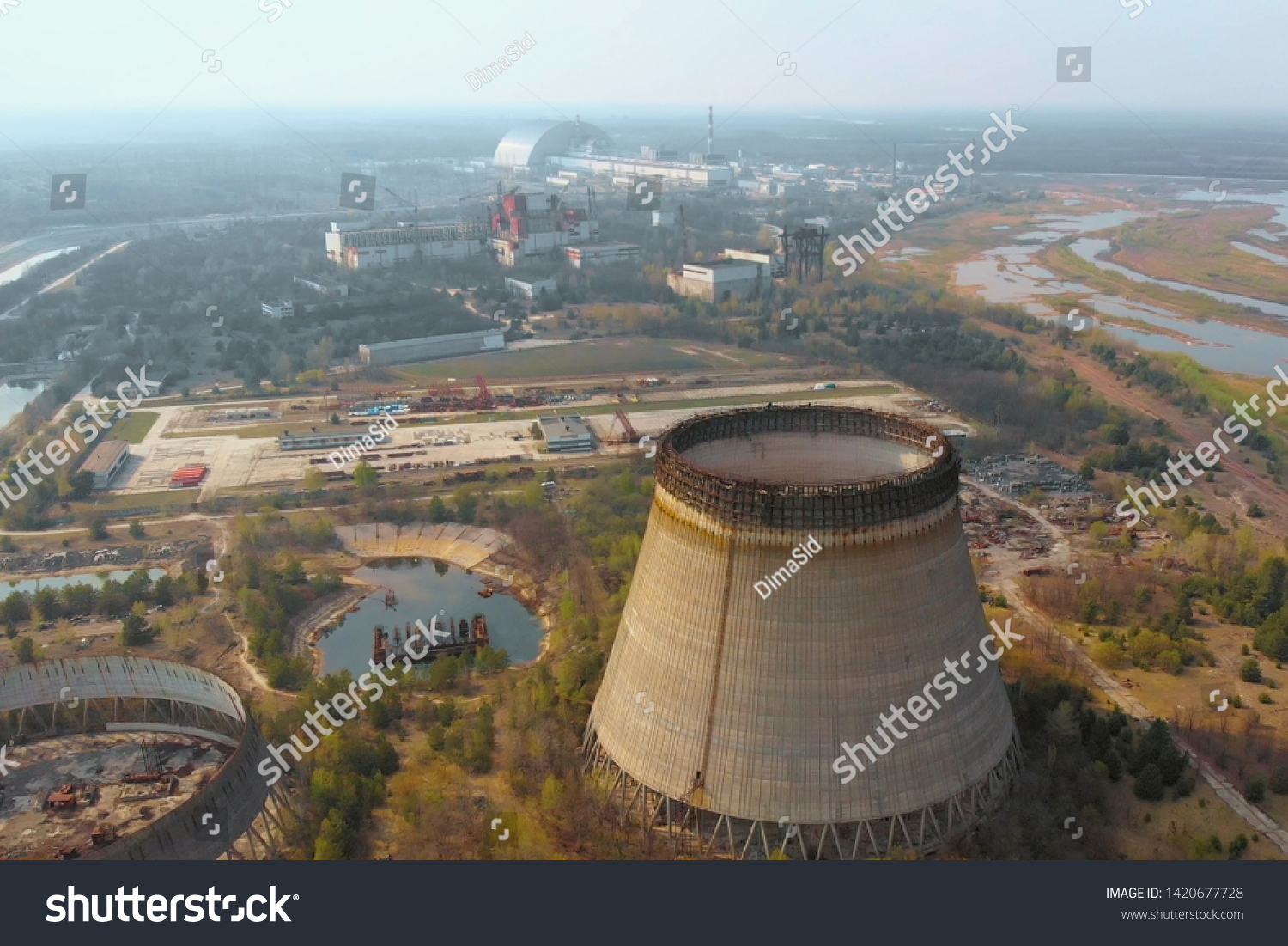 Chernobyl nuclear power plant. Cooling tower overlooking the nuclear power plant in Chernobyl. View of the destroyed nuclear power plant. Chernobyl nuclear power plant, aerial view. Chernobyl NPP #1420677728