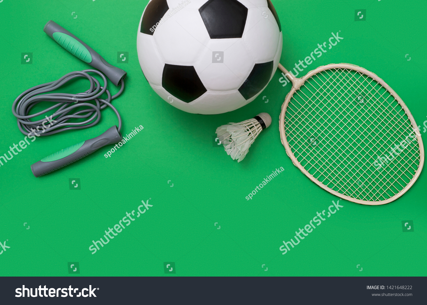 Sport equipment and ball on green background  #1421648222