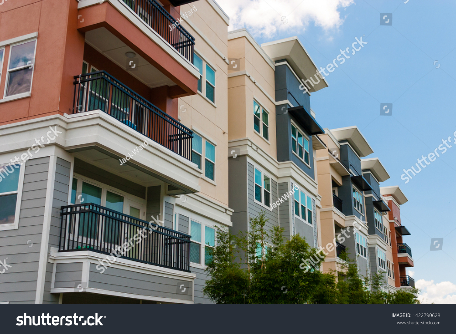 Modern luxury urban apartment building exterior with blue sky. #1422790628
