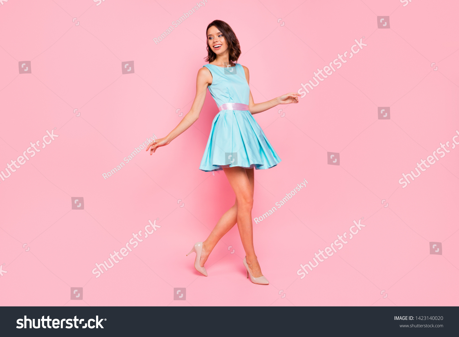 Full length side profile body size photo beautiful she her lady going graduation college university school walking street wear high-heels colorful blue dress isolated pink bright vivid background #1423140020