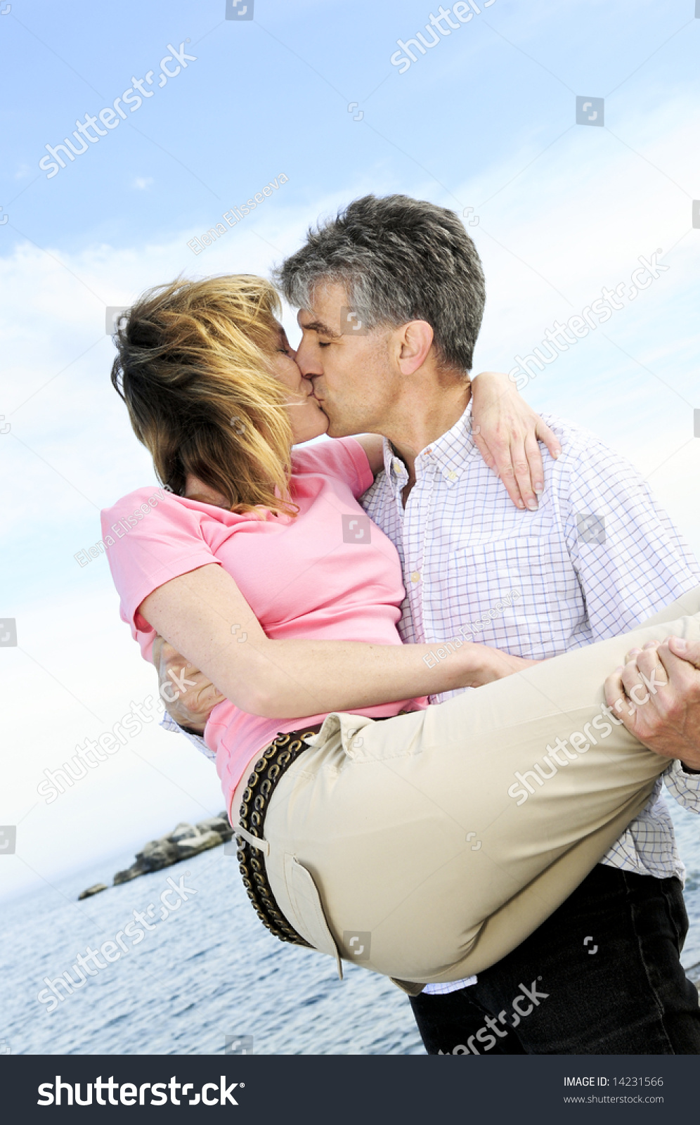 mature romantic couple baby boomers kissing stock photo (royalty