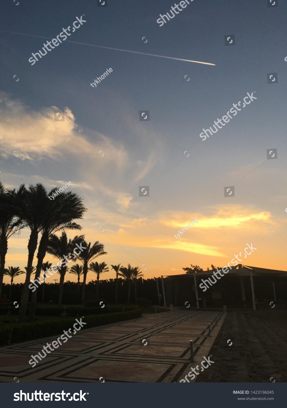 stock-photo-tropical-sunset-beach-yellow