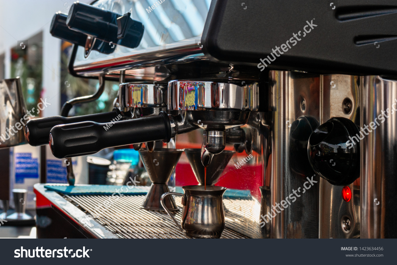 Coffee machine in coffee house producing espresso coffee