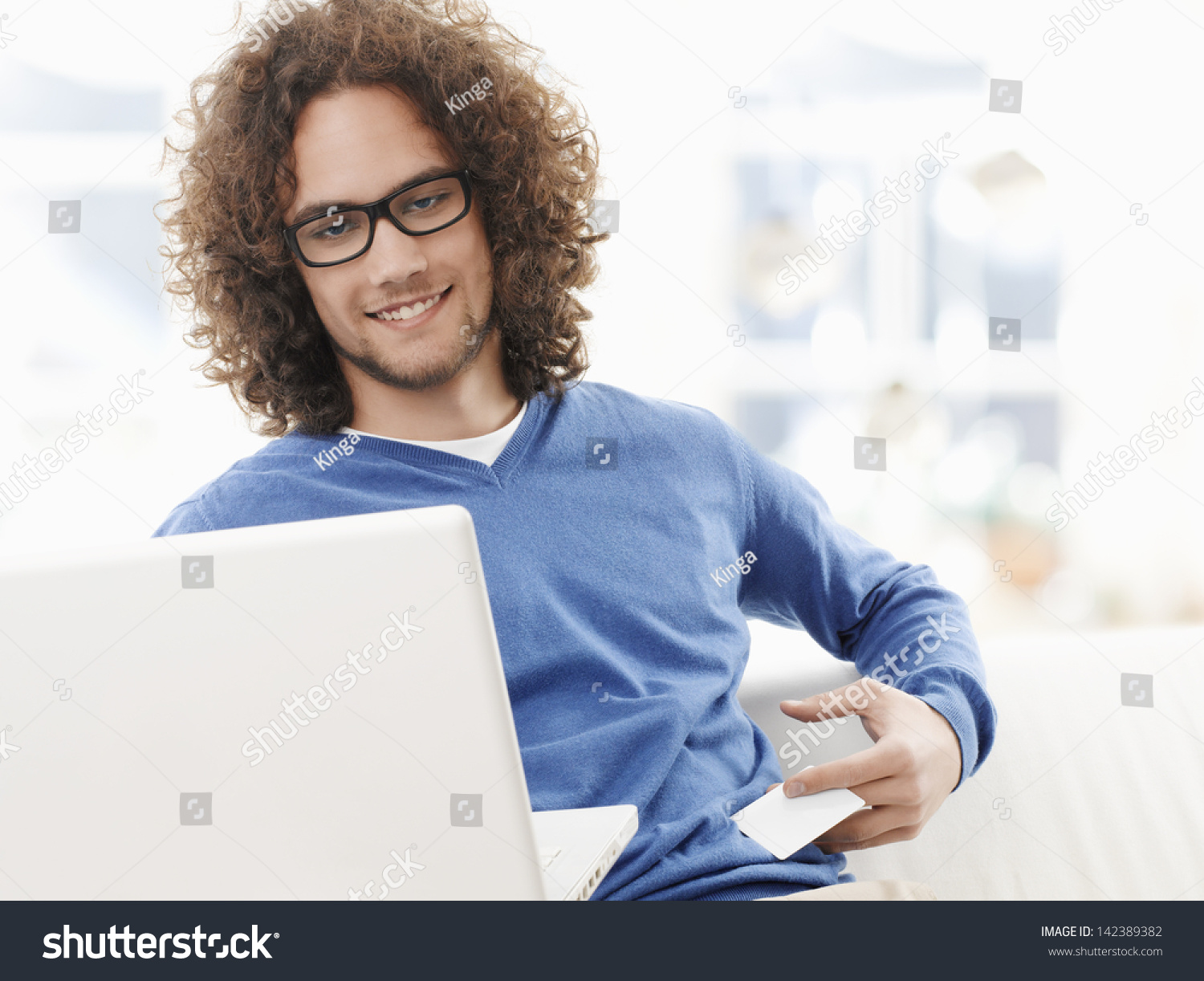 Young Serene Smiling Man Holding Credit Stock Photo ...