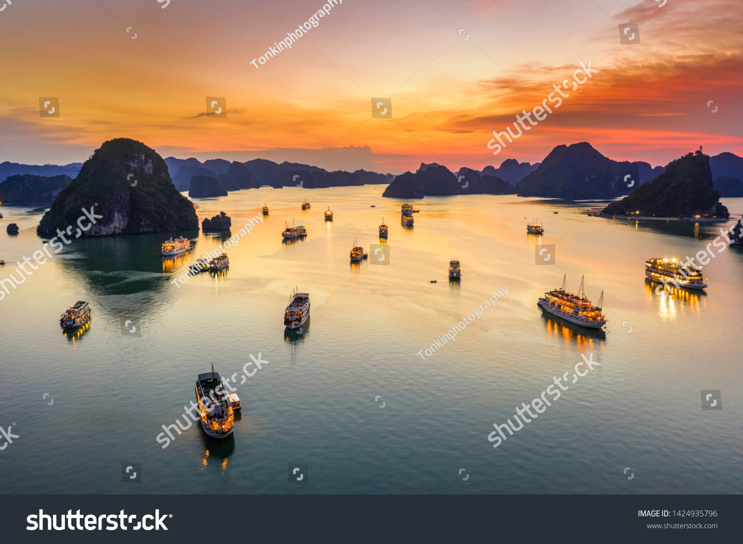 Aerial view of sunset and dawn near rock island, Halong Bay, Vietnam, Southeast Asia. UNESCO World Heritage Site. Junk boat cruise to Ha Long Bay. Popular landmark, famous destination of Vietnam #1424935796