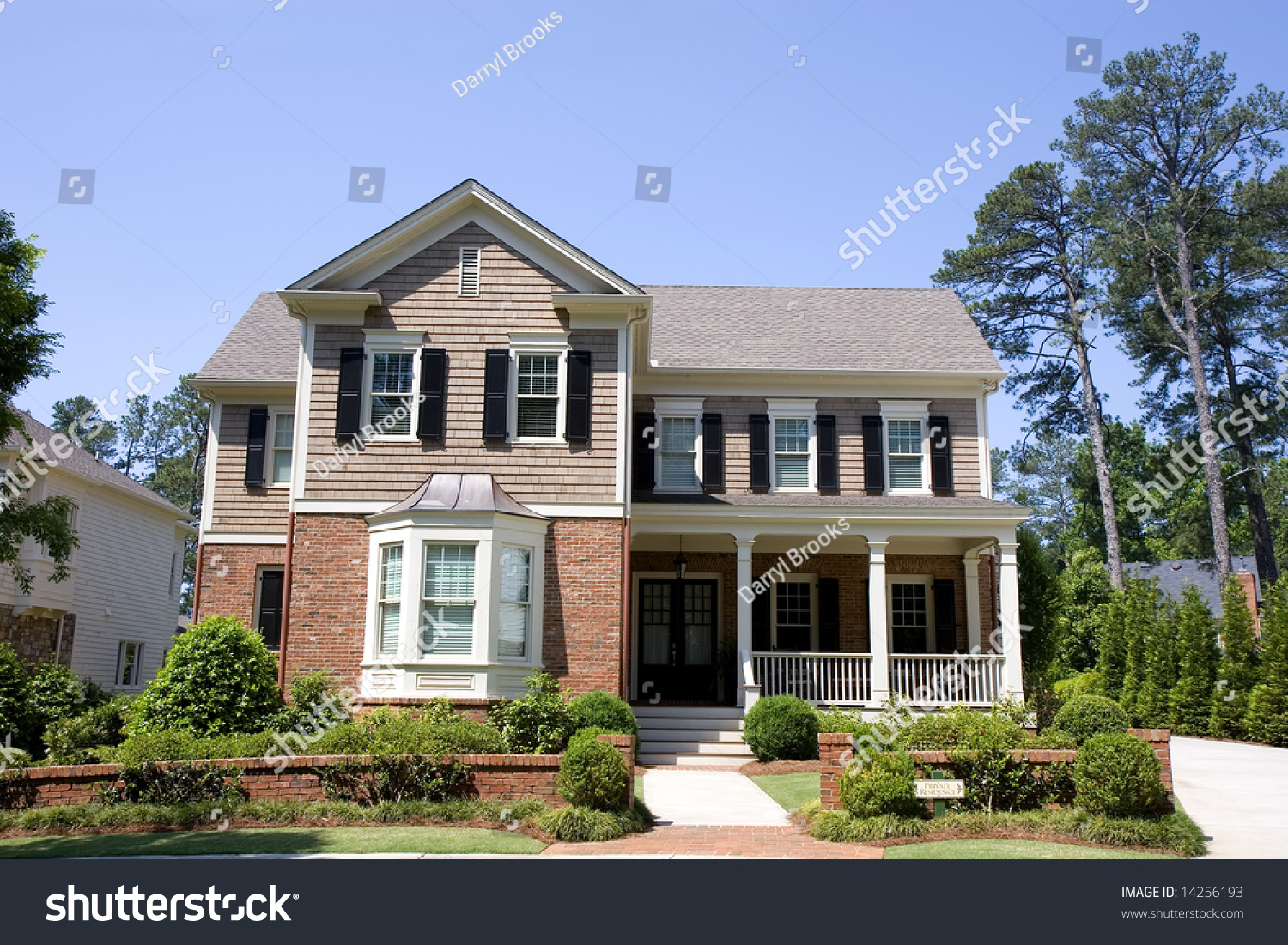 A Nice Traditional House Of Brick And Wood Stock Photo