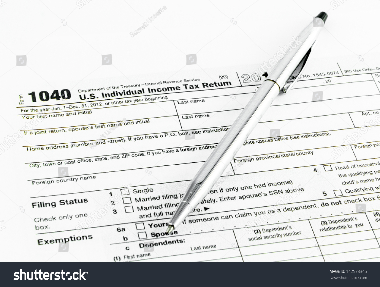 Tax form 1040 tax year 2012 stock photo 142573345 shutterstock tax form 1040 for tax year 2012 falaconquin