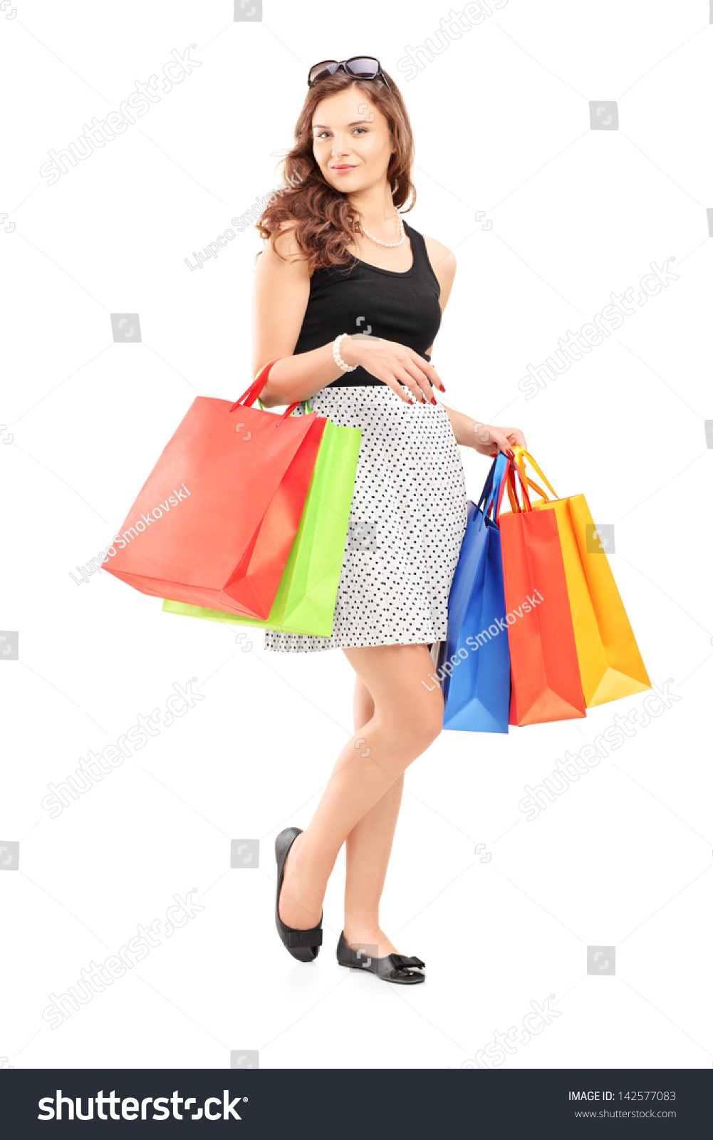 Woman posing with shopping bags isolated on white background full - Full Length Portrait Of A Beautiful Young Woman Posing With Shopping Bags Isolated On White