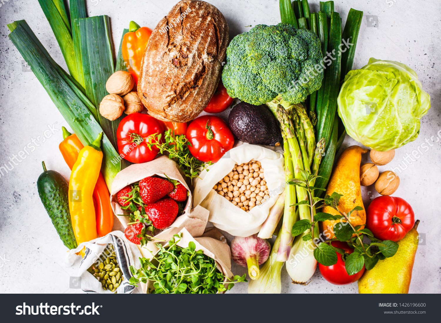Balanced vegetarian food background. Vegetables, fruits, nuts, sprouts, seeds, chickpeas on a white background, top view. #1426196600