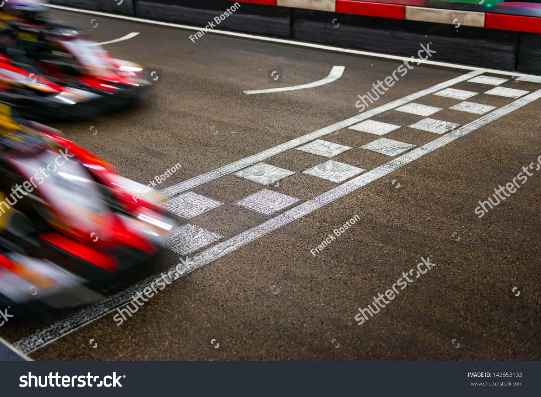 Finish Line Photography: Kart Crossing The Finish Line Stock Photo 142653133