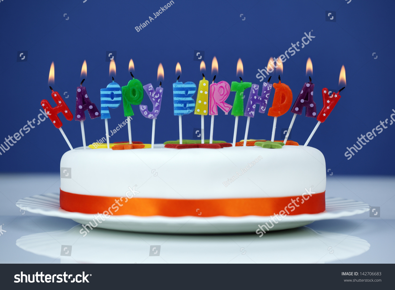 Happy Birthday Candles On White Cake Stock Photo Edit Now