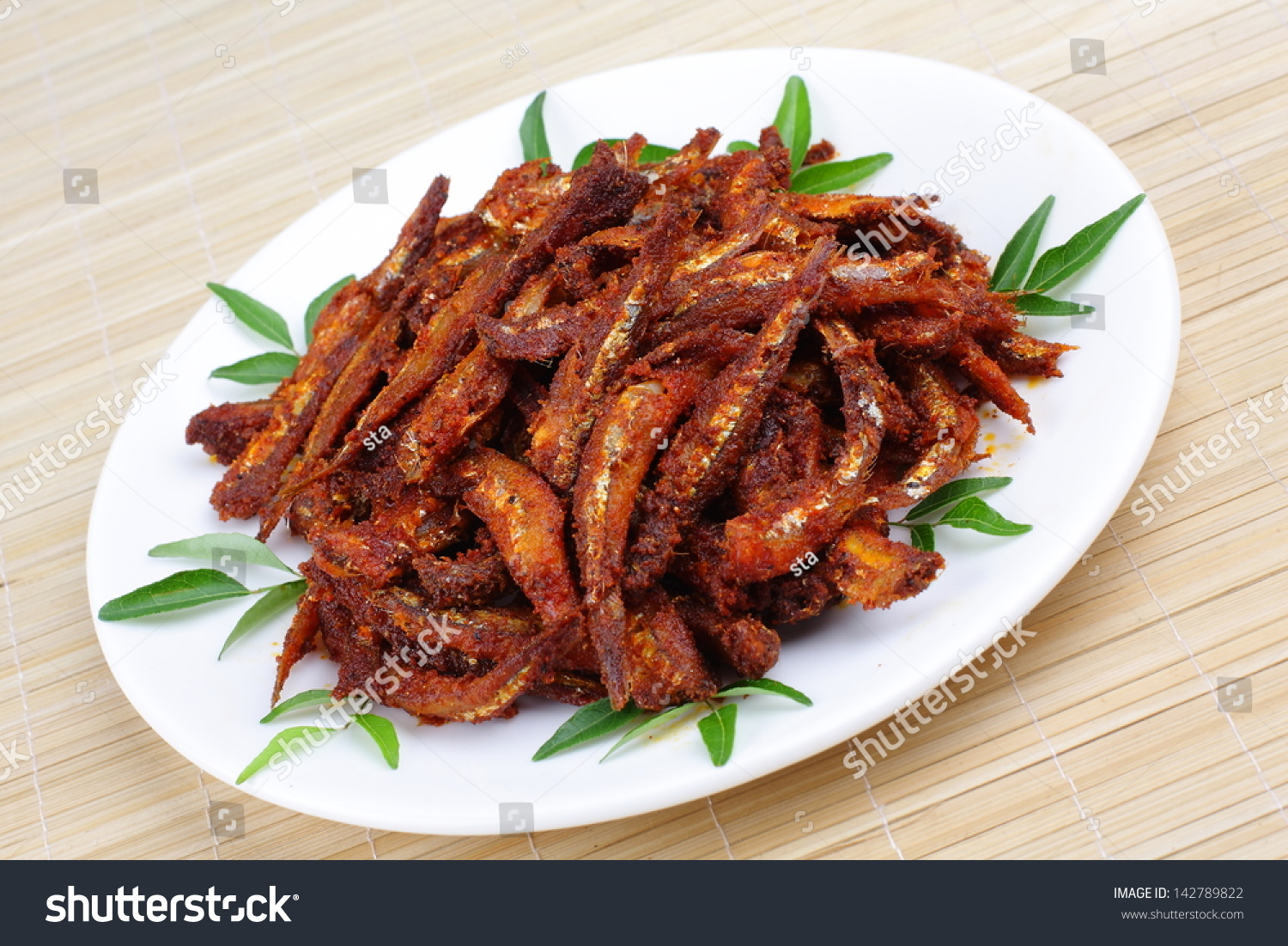 Side view anchovy fish fry curry stock photo 142789822 for Sides to bring to a fish fry