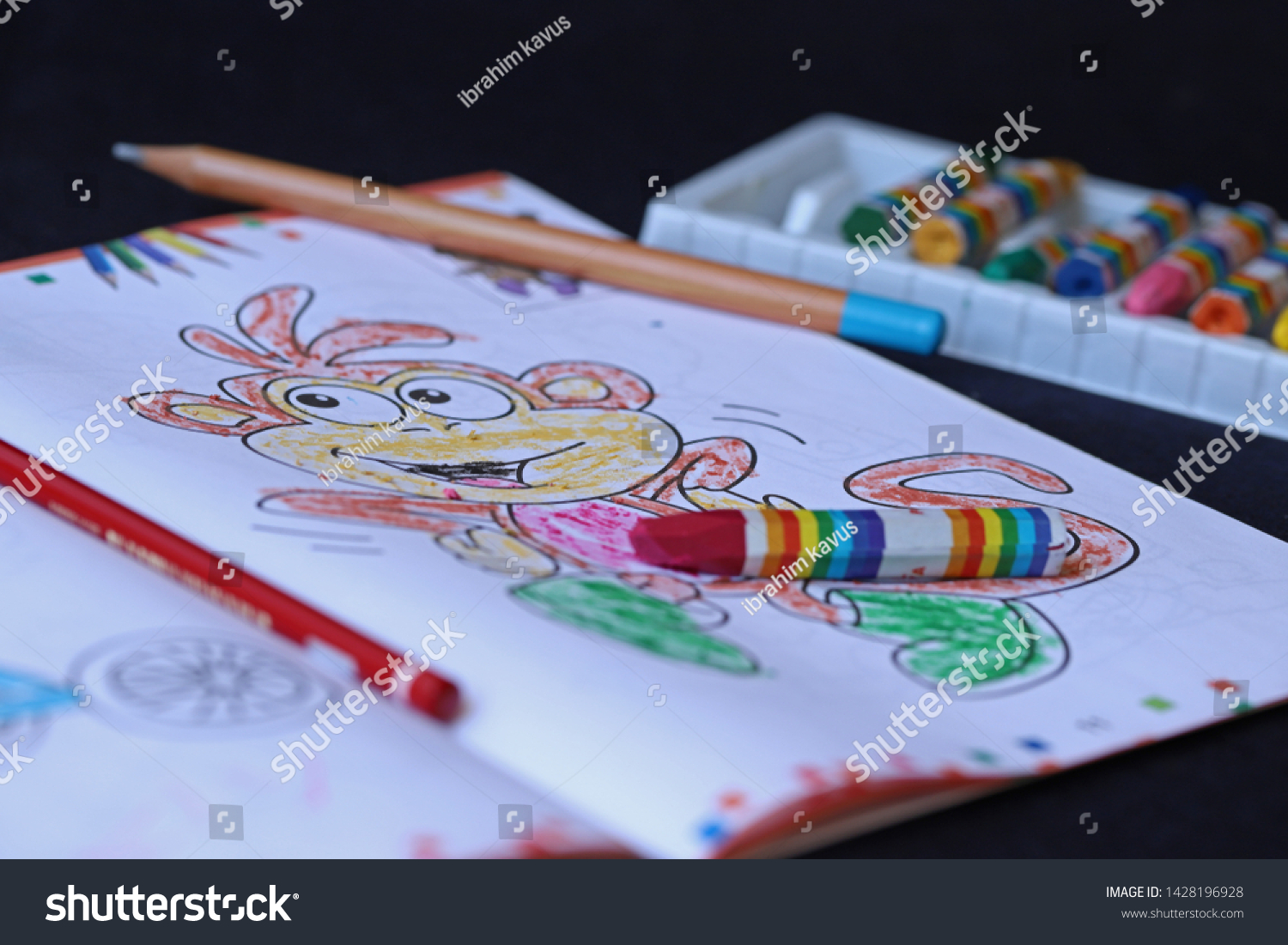 coloring books crayons over black