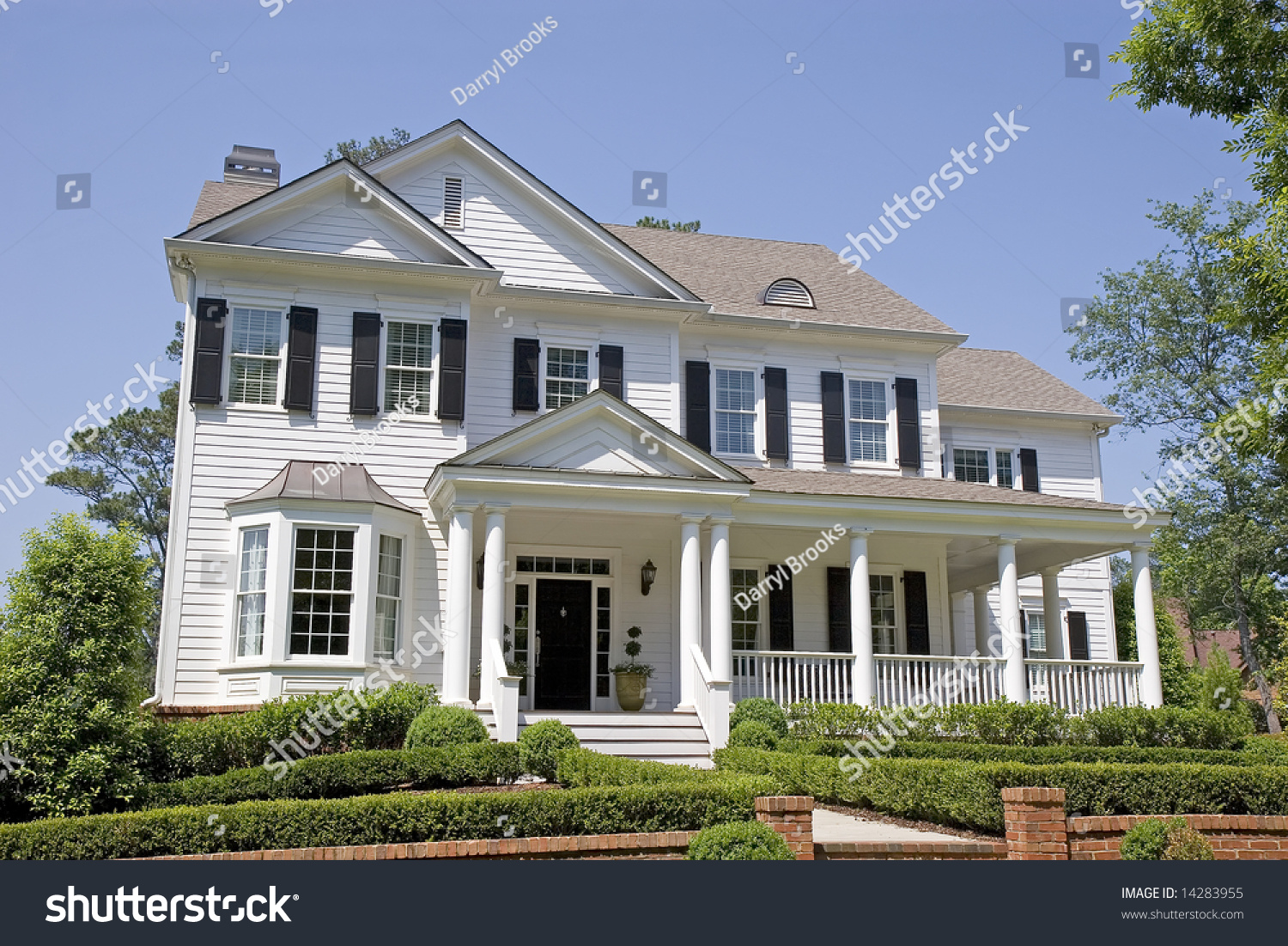 White two story traditional house front stock photo for Traditional 2 story house