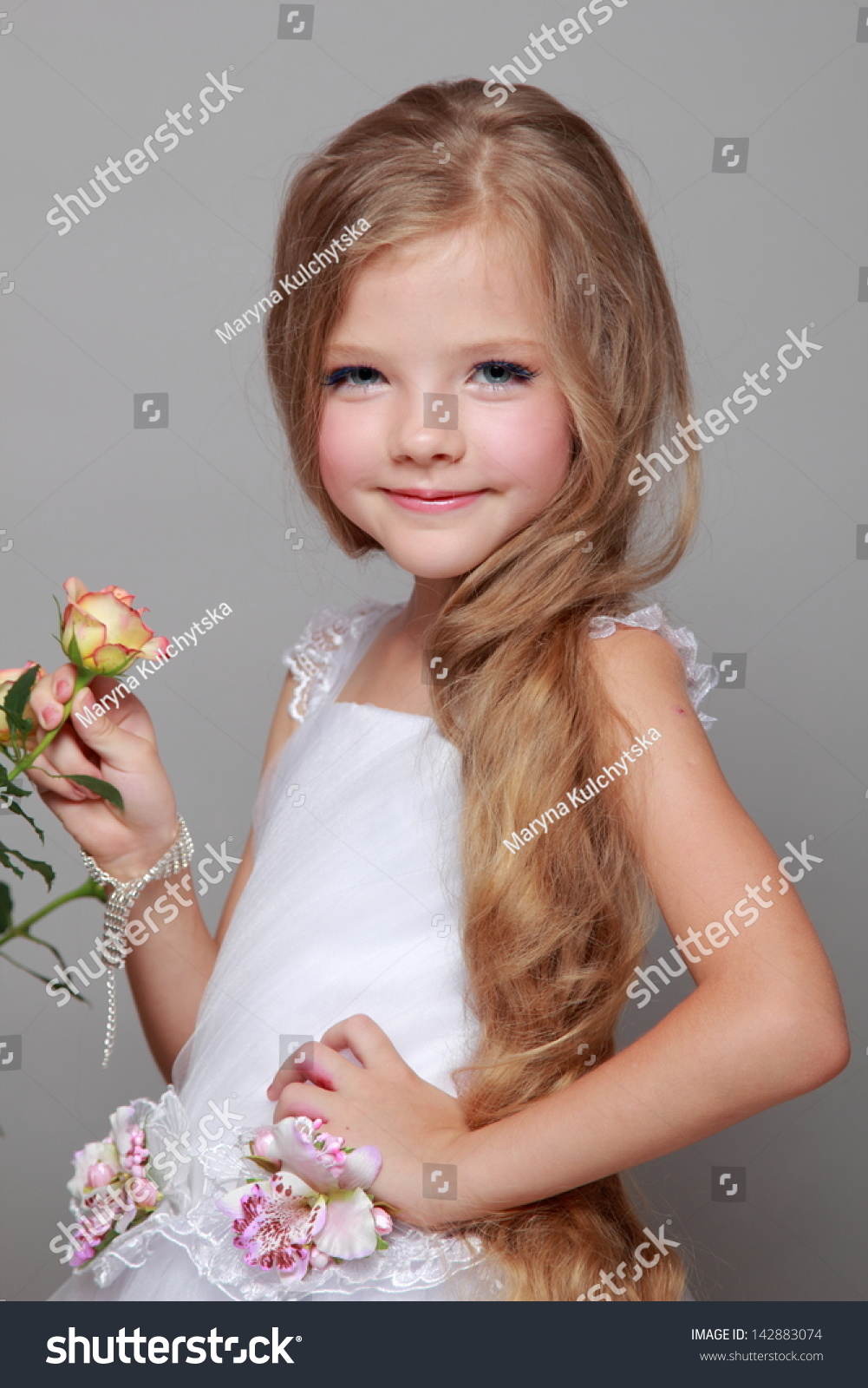 Pretty Young Girl Long Hair Holds Stock Photo 142883074