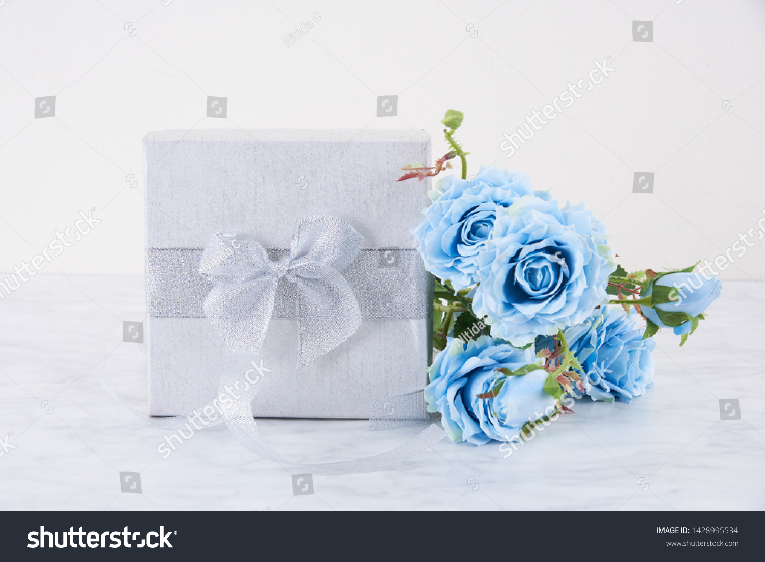 Silver Gift Box Silver Ribbon Blue Stock Photo Edit Now 1428995534
