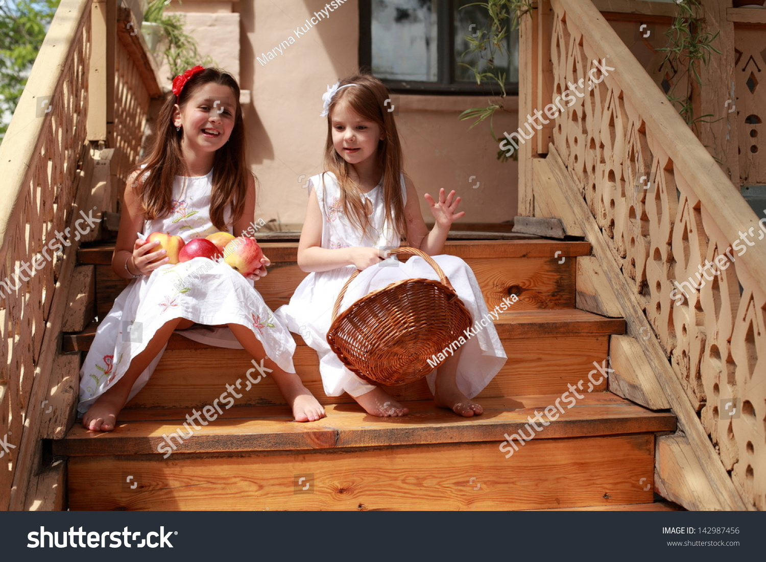 https://image.shutterstock.com/z/stock-photo-two-little-girls-in-white-dresses-and-bare-feet-holding-a-basket-of-apples-142987456.jpg