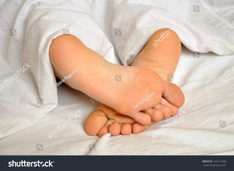 Sleeping Teen Girl Feet Under Blanket Stock Photo -4474