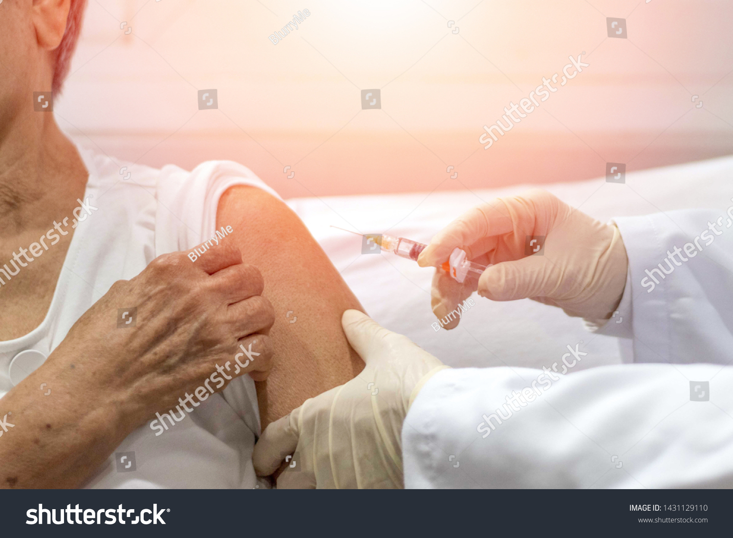 Senior vaccination concept. Elderly getting immune vaccine at arm for flu shot, pneumonia, and shingles(MMR) in hospital by nurse. Doctor giving an injection to older people patient in clinic. #1431129110
