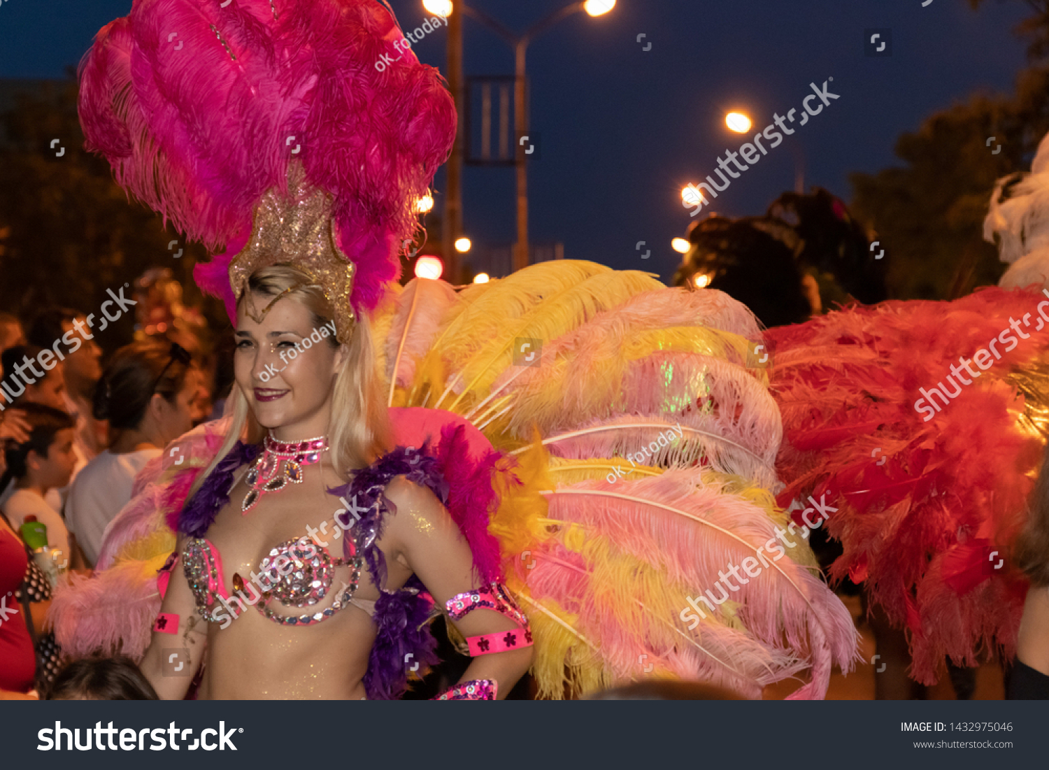 Dancers in costumes of ostrich feathers. Annual summer carnival. Pancevo, Serbia, June 22, 2019
