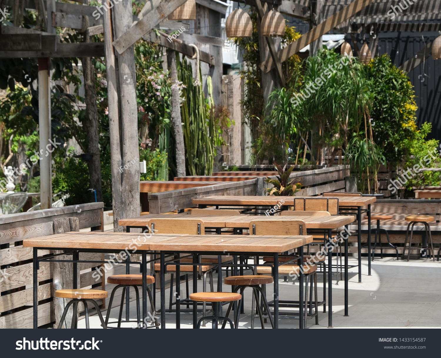 Outdoor setting for food and beverage outlet with blurry vegetation as background