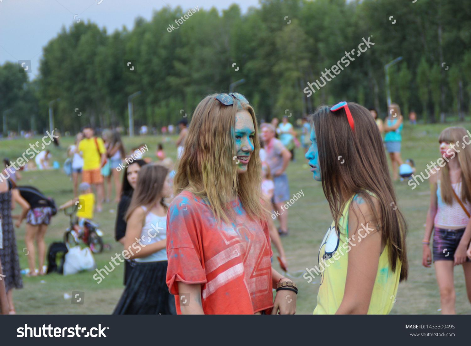 Two girls with faces in the paint at the festival of colors Holi on the island Tatysheva. Russia, Krasnoyarsk. August 22, 2015