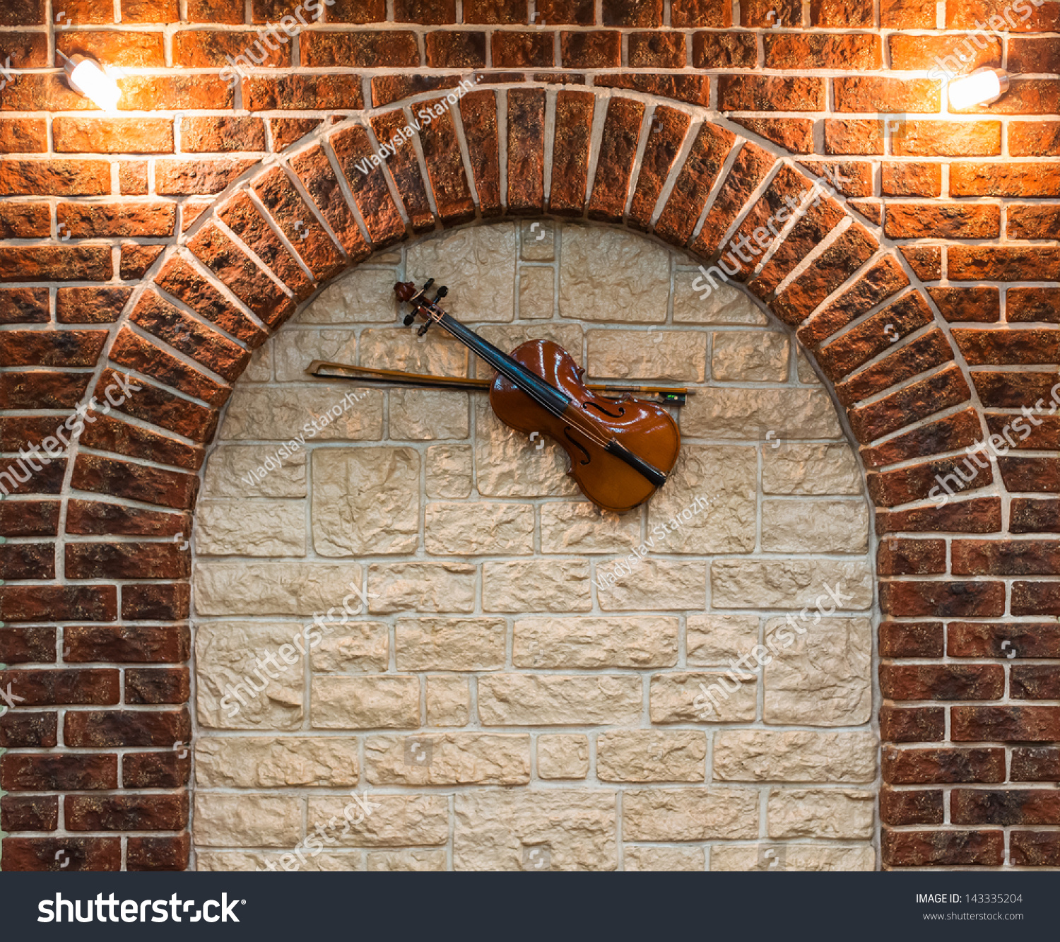 Element of the interior stone arch with a violin on a wall for Interior wall arches