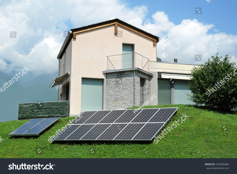 small building solar panels backyard stock photo 143496484