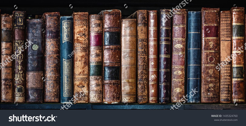 Old books on wooden shelf. Tiled Bookshelf background.  Concept on the theme of history, nostalgia, old age. Retro style. #1435324760