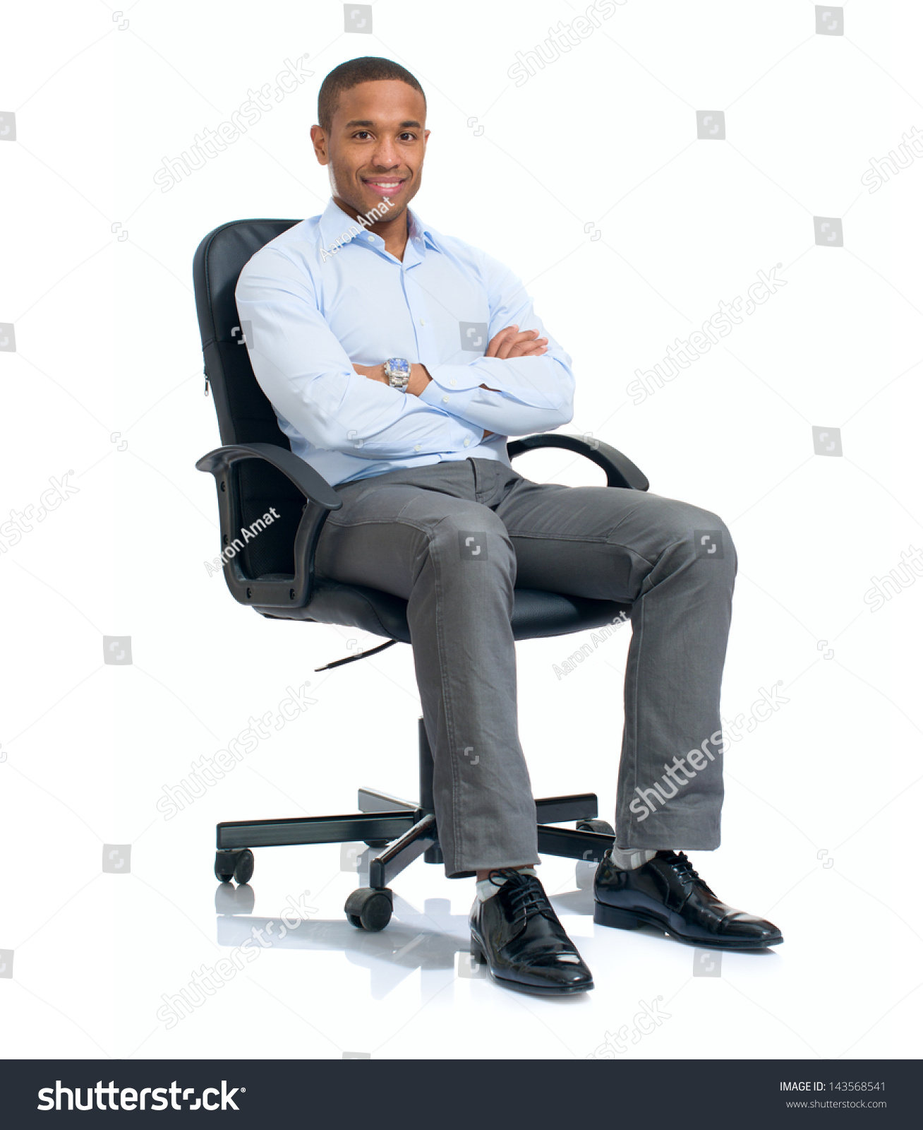 stock-photo-young-african-businessman-sitting-on-chair-over-white-background-143568541.jpg