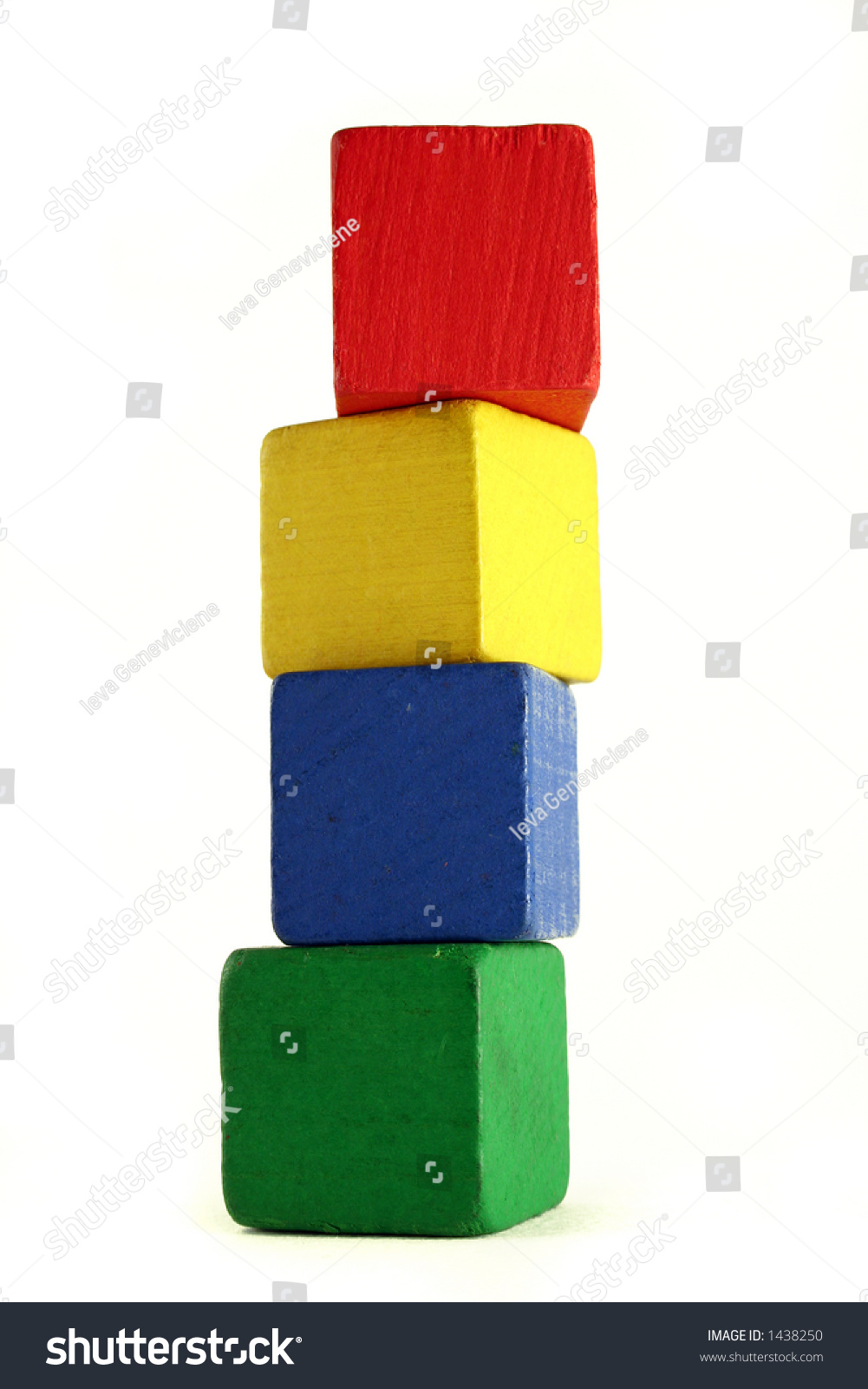 four wooden childrens blocks different colors stock photo